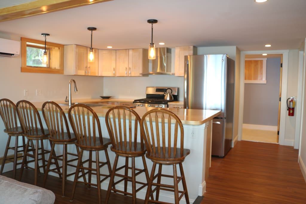 Stools at bar in kitchen area