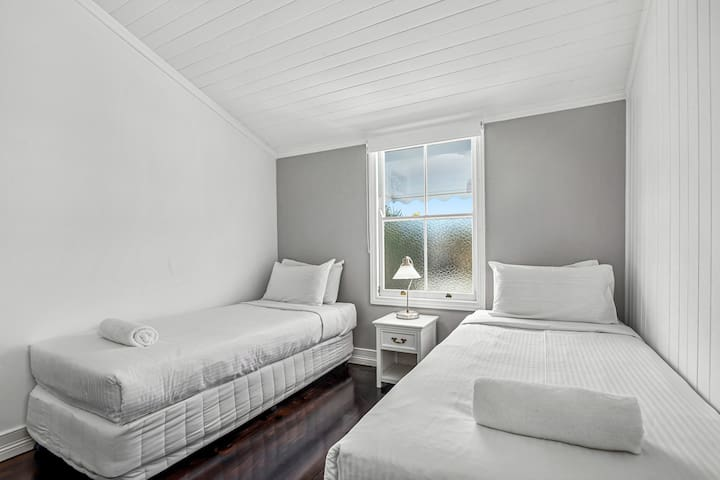 The lovely second bedroom comes with two single beds, ideal for those travelling in a group or with the kids.