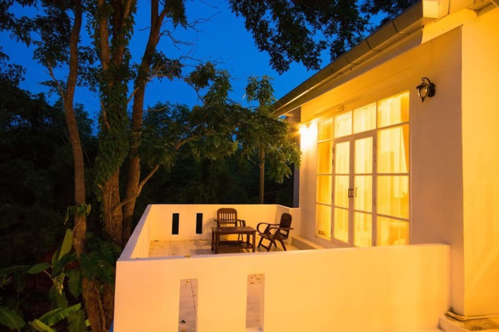 Spending time on a balcony overlooking the pool at dusk in the peaceful surroundings.