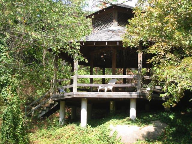 outdoor gazebo on property overlooking river