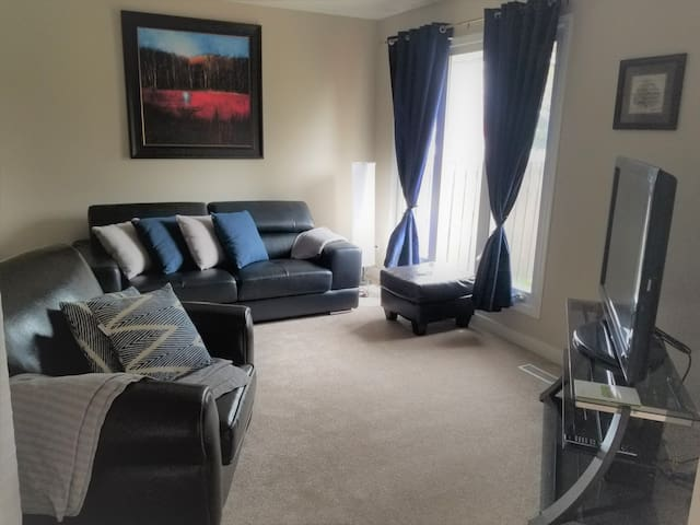 Cozy living room - perfect for a relaxing glass of wine after a long day of shopping!