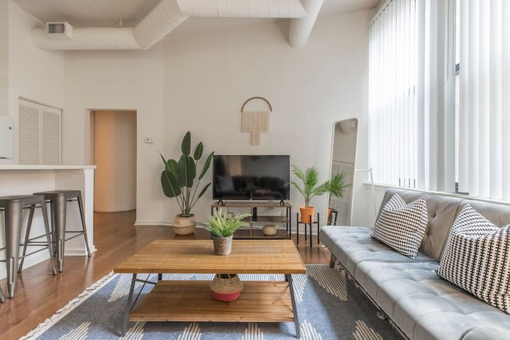 Comfortable living room with tons of natural light!