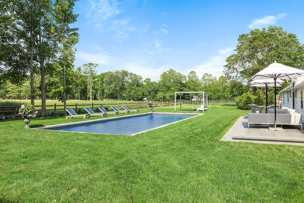 Pool overlooking horse farm