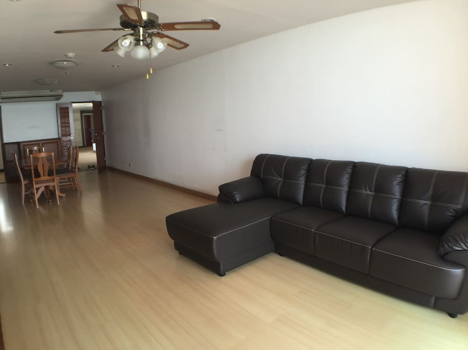 spacious living room. Sea view balcony is beside the sofa.