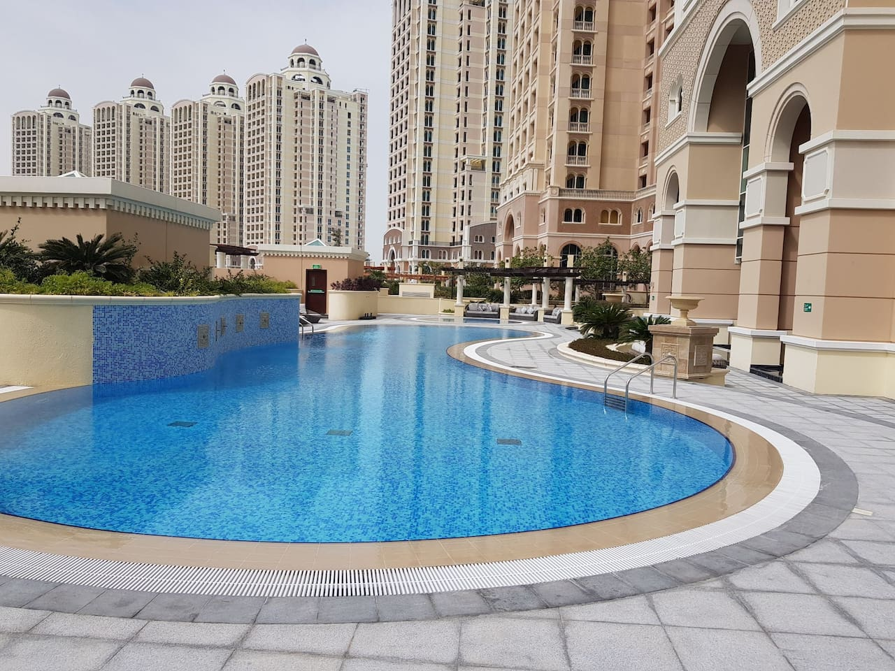 Large open pool with lots of sun fresh air and sun beds