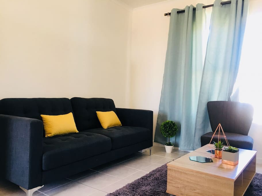 """Stylish, modern lounge with comfortable couch and 50"""" Television"""