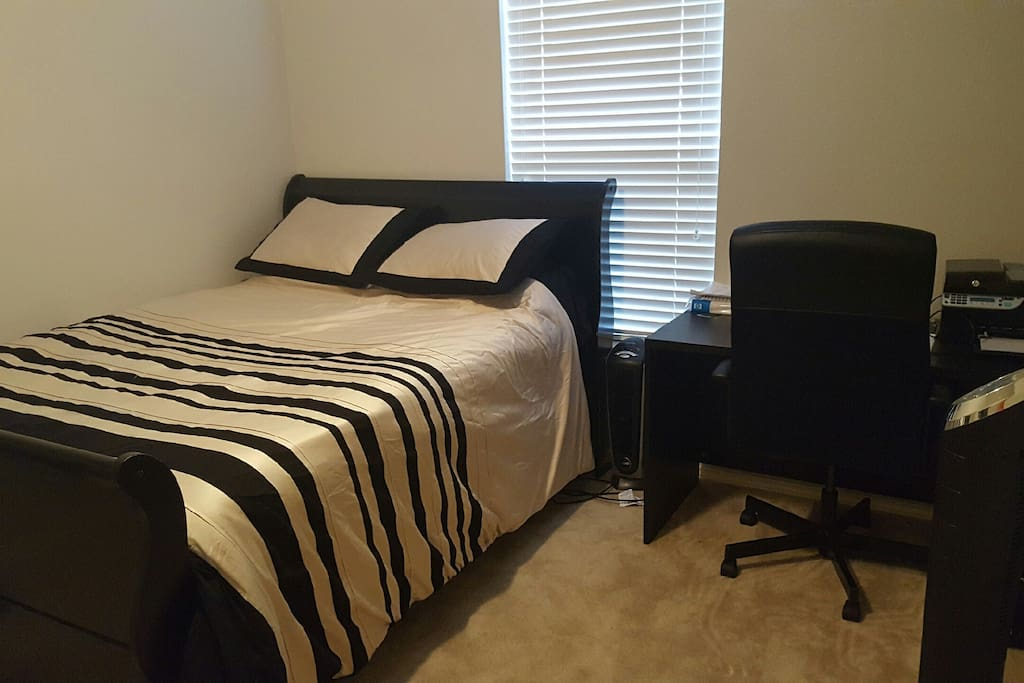 Bedroom with very comfy queen size mattress. Air mattress available upon request.