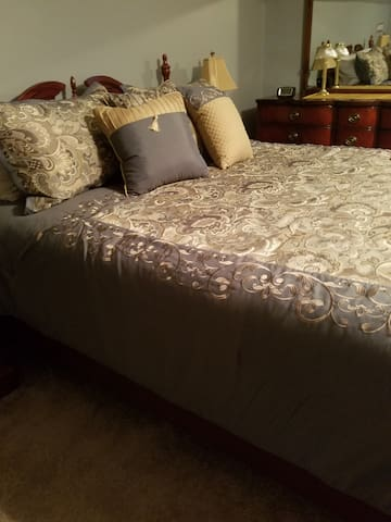 Freshly redecorated spacious bedroom with comfy queen bed
