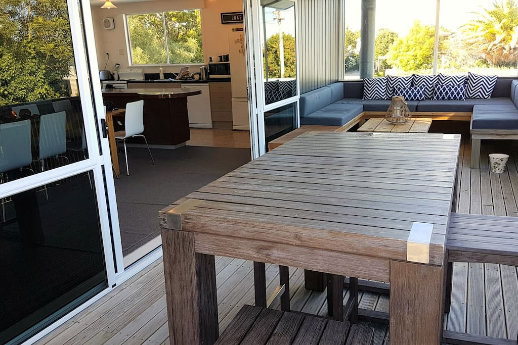 Outdoor table with bar stools