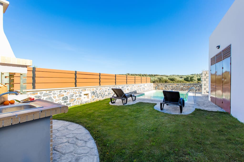 Garden area with private swimming pool and sun beds