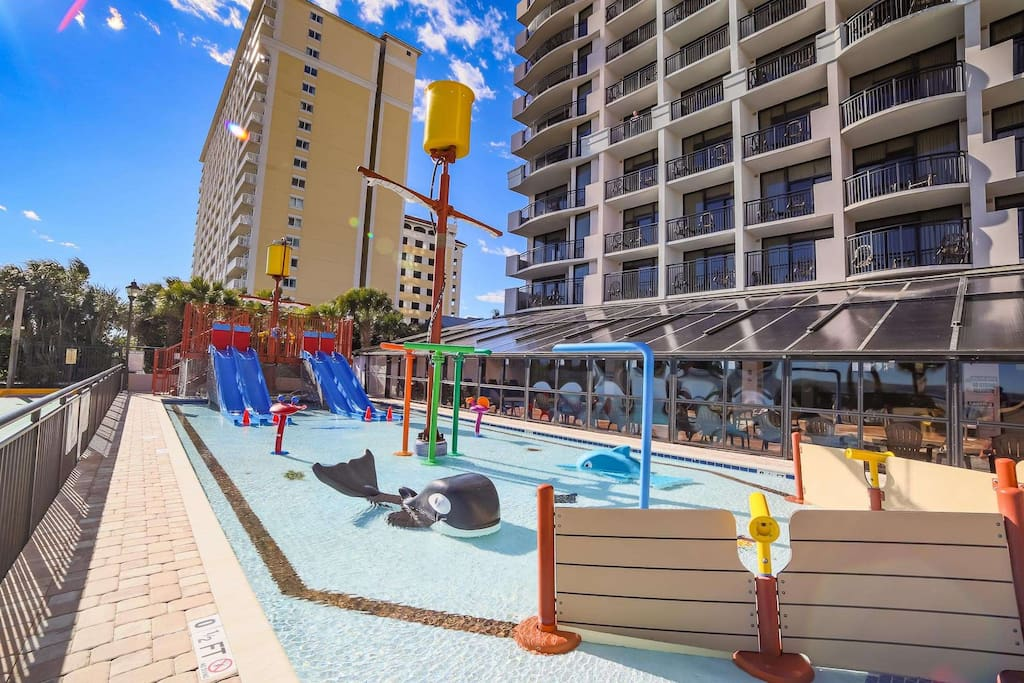 Kids love the water slides and toys in this oceanside pool