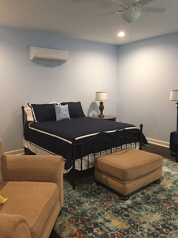 King size bed with comfortable bedding, also a futon couch folds out in to a full size bed.