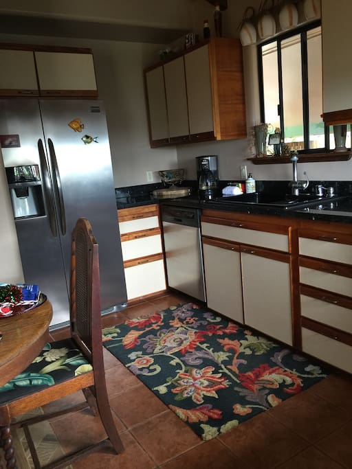 Large refrigerator and dishwasher, dining table