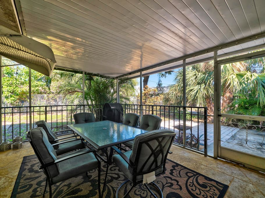 The covered porch has a propane grill and glass-top table that seats 6.