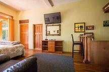 "Interior kitchenette/bar, 42"" flat screen TV."