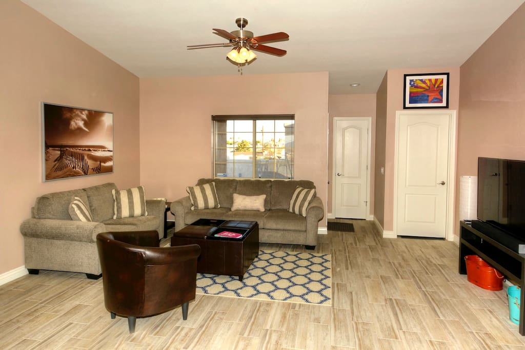 Living room - couch has a hide-a-bed, Apple TV, Smart TV, cable TV