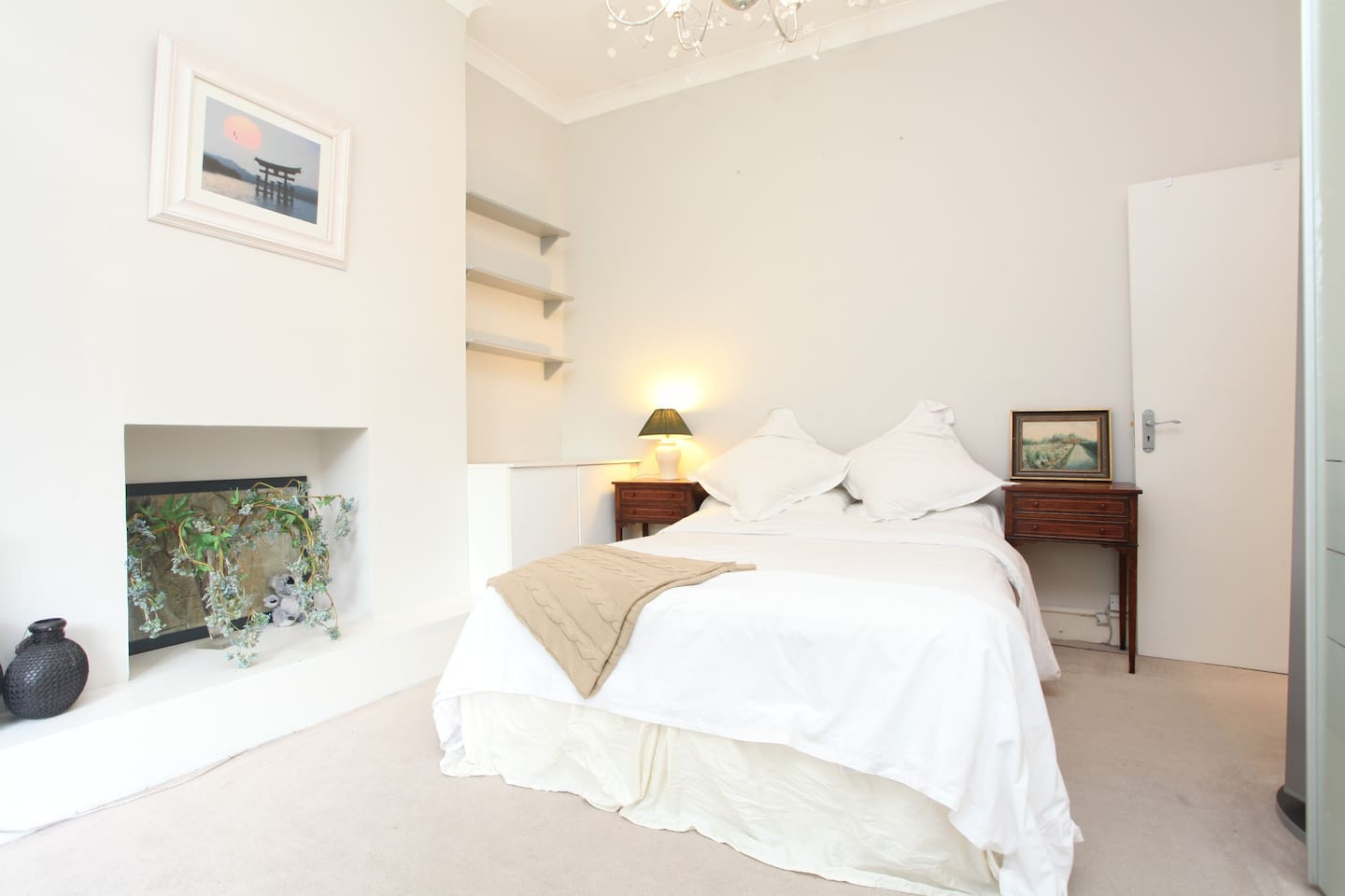 Neutral colours in a light and airy bedroom with a direct exit to the outdoor patio