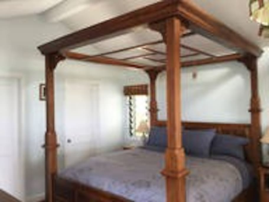Very comfy California king bed with dream catchers.