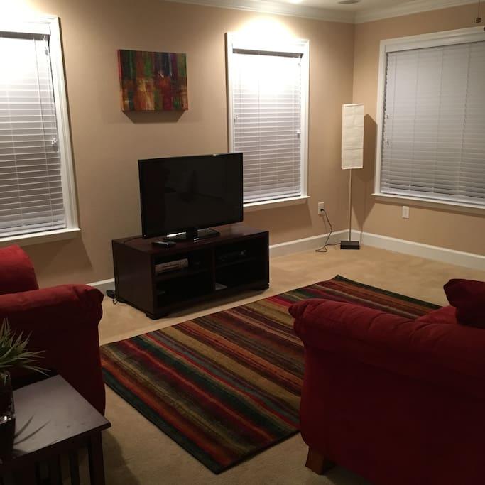 Living Room -- sofa, chair, TV