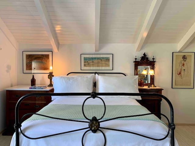 The master bedroom a nest set in a truly authentic setting is the ultimate summer sanctuary spurring with serenity A white and green palette make the master bedroom a bright and dreamy suite that consists of a double bed with ensuite bathroom