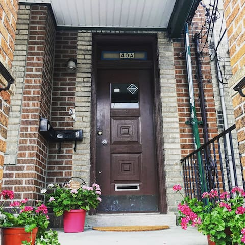 Front door leads to two separate private apartments with separate entrances. Yours is on the top floor.