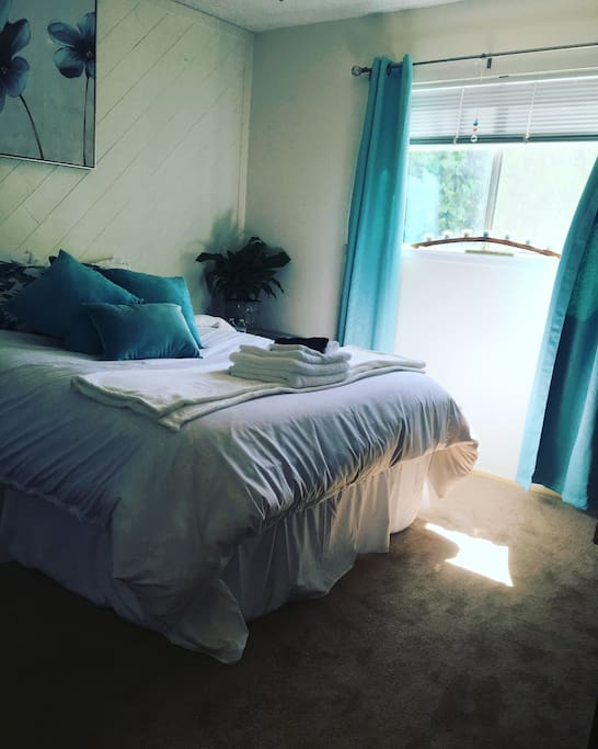 Guest Room. Fresh white linens, blue decor, and a cozy bed.