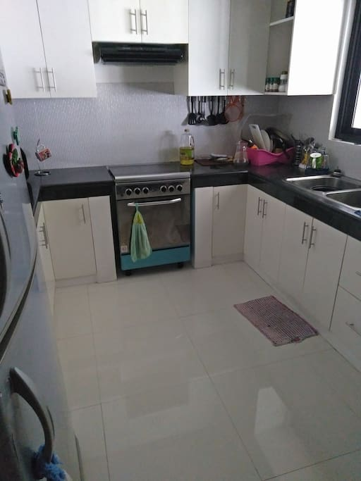 Full access to kitchen with stove and oven