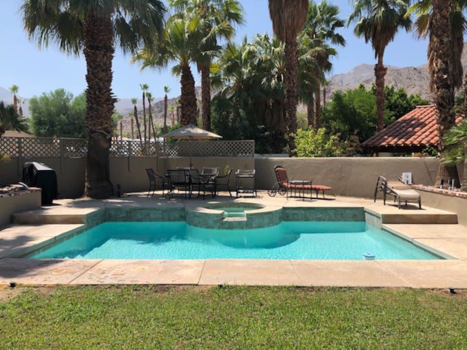 The pool and patio at Casa Caballero, a three-bedroom home with a separate one-bedroom guesthouse or casita. The property is in the elegant La Quinta Cove.