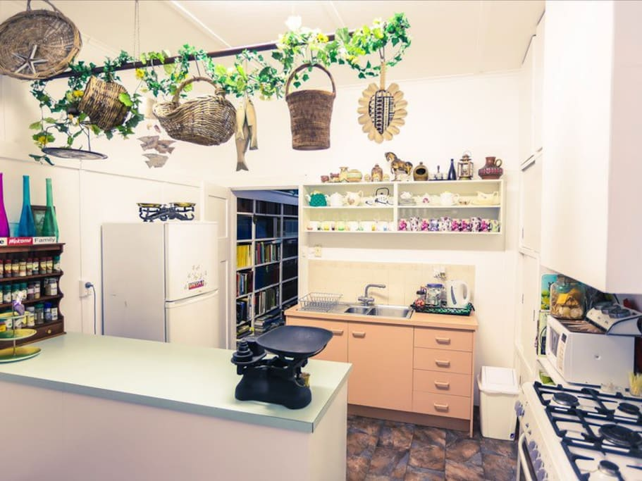 The country kitchen has a large oven, fully stocked pantry and fridge.