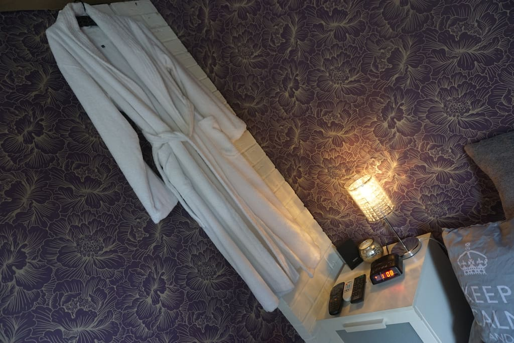 Bedroom 3 - Side lamp, alarm clock, dressing gown, remotes for entertainment systems