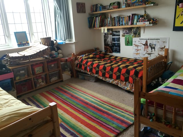 Children's room with 2 single beds and pull out bed