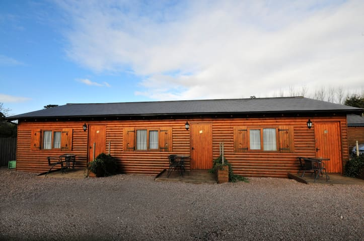 The front of the B n B cabins which have ample car parking