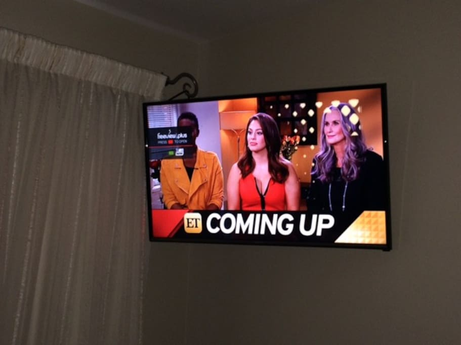 New 32 inch Smart TV in your room.  Has Netflix, Google, USB to view your photos etc.