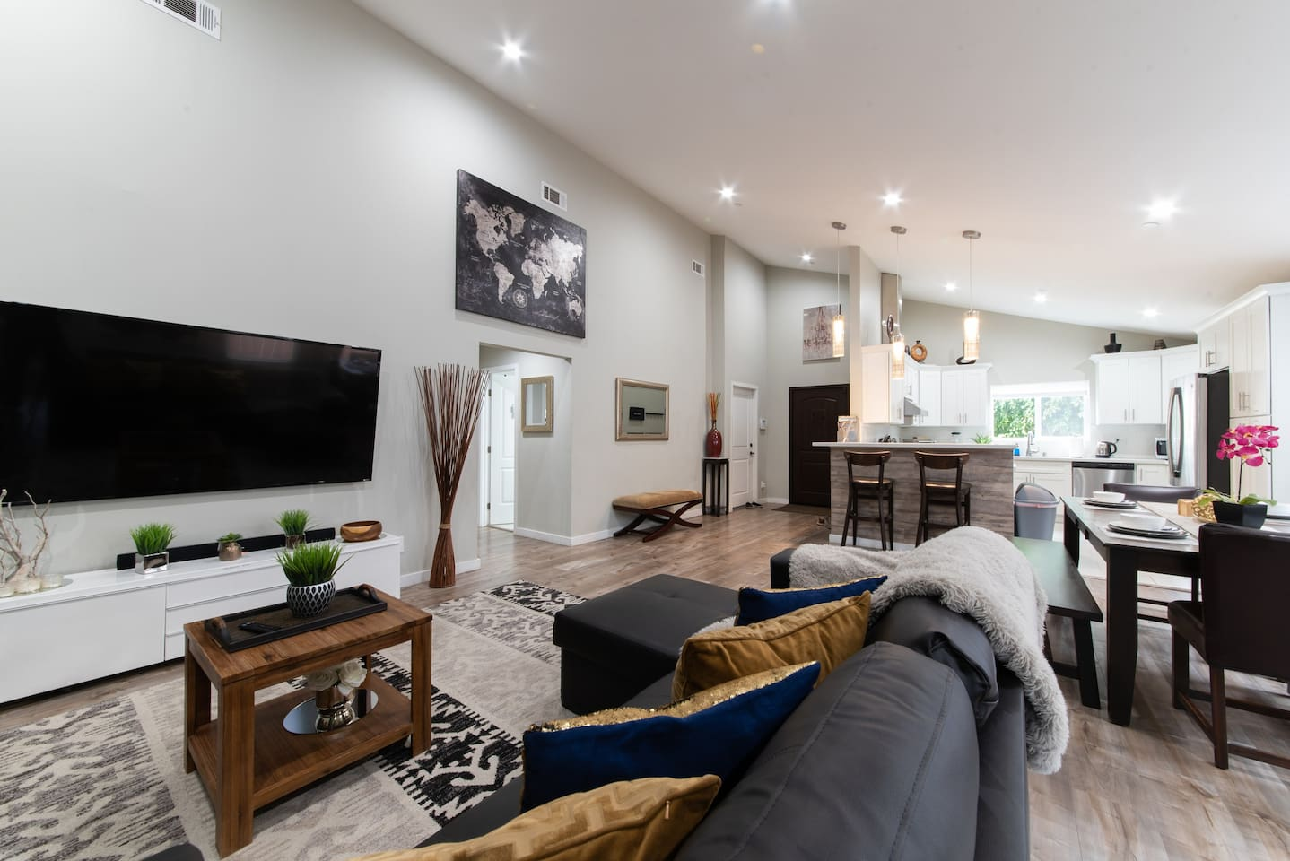"""Experience this modern living room where everyone can gather around the expansive 75"""" 4K Smart TV."""