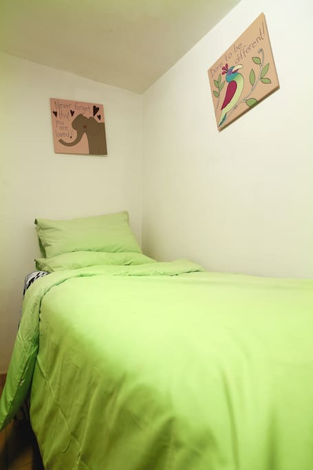 This is a small room with basic 1 single bed and 1 small desk