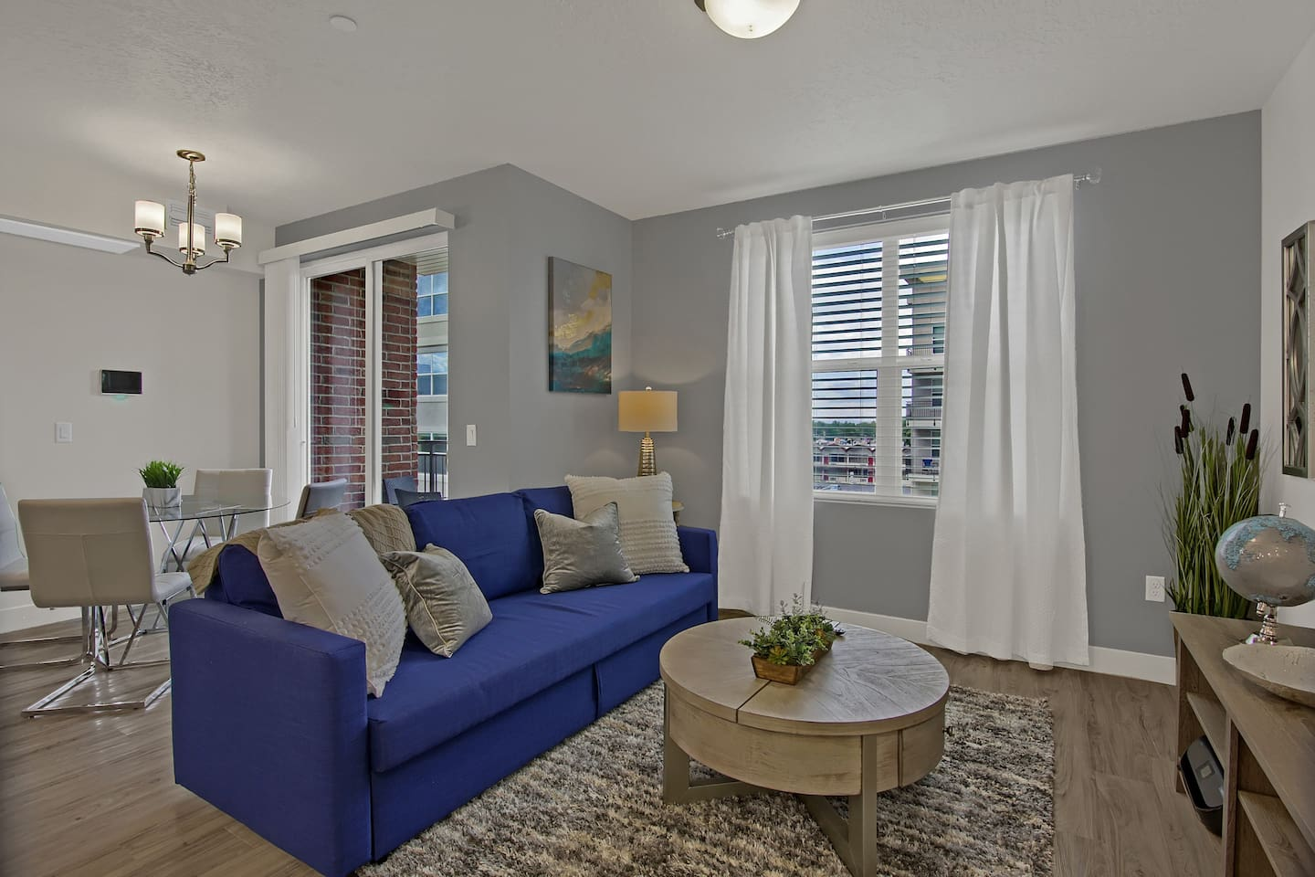 2 bed / 2 bath elite apartment with sleeper sofa, dinning area, and articulating coffee table