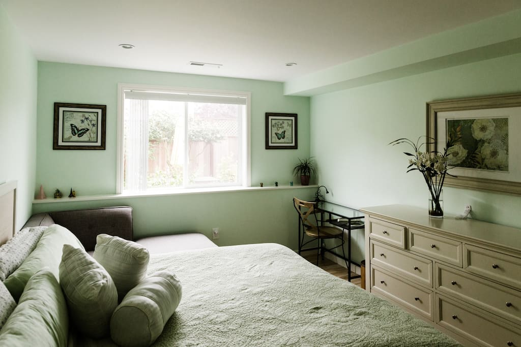 Suite eastern king bedroom. Guest usage of king bed, 7 drawer chest of drawers, reading chaise that can be use as toddler bed, laptop desk and chair. Closet with luggage rack and guest bathrobes.