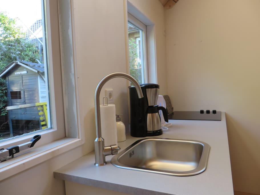 The kitchen has a coffee machine, water boiler and basic cooking facilities.