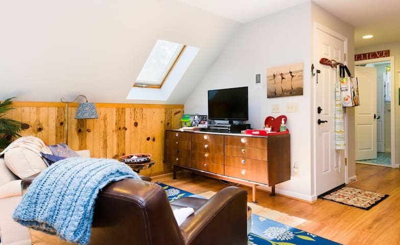 """Living area and entertainment center with 32"""" Smart HDTV with Comcast Xfinity's Digital Preferred Package (with FULL range of networks, incl. local news)"""