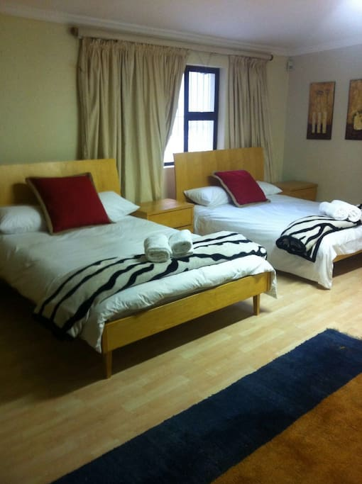 Room 5 Sleeps 4 to 6 people in one room, with bathroom en suite and TV.