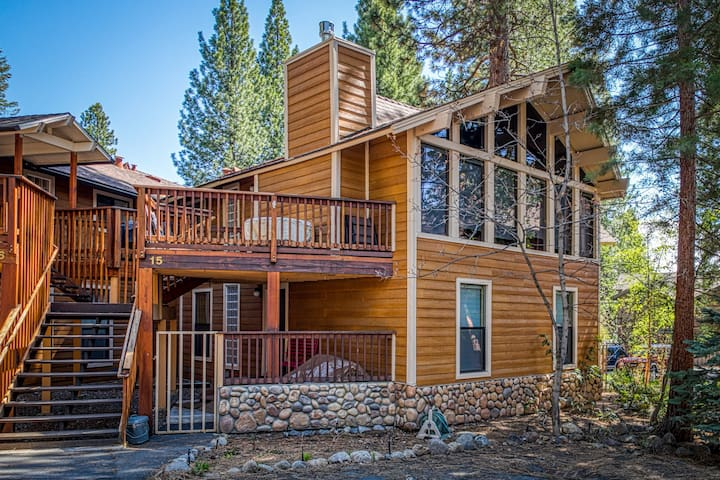 Elegant cabin w/ fireplace, multiple patios & forest views - walk to beaches!