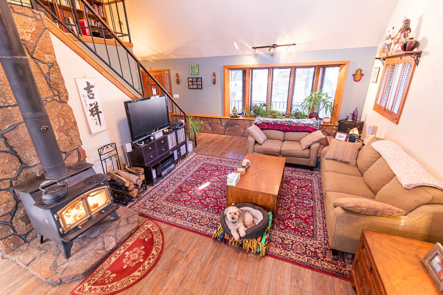Overview (1/5): Beautiful living area with vaulted ceilings and wood-stove. Chester posing in his bed--for treats of course  Chris (host) is a professional photographer and took all images himself with a Nikon D750