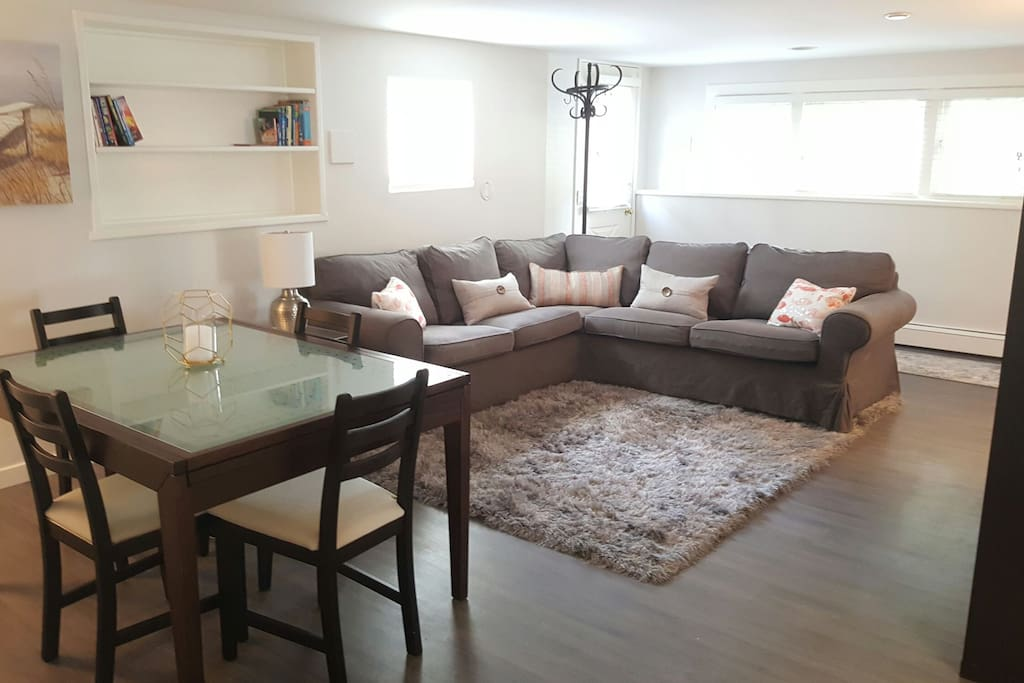 Lots of seating space in this open concept living and dining room. Full cable TV and WiFi provided.