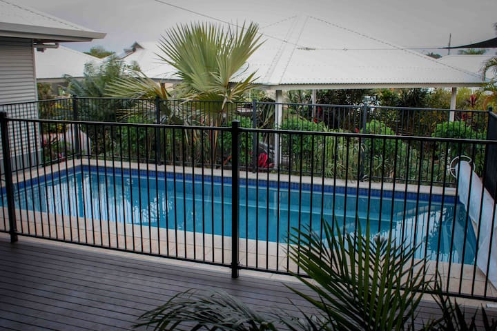 The pool is in the decked area between the owners and guest apartments.