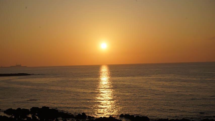 the sunset of Samyang Black Sand Beach