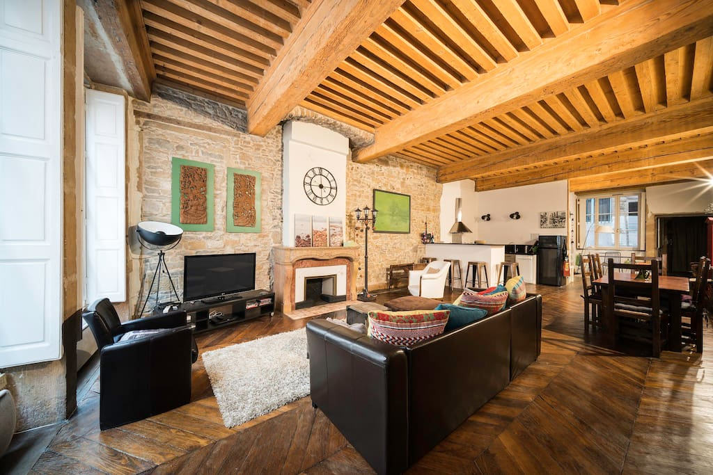 Wooden floor and high beamed ceiling are original.