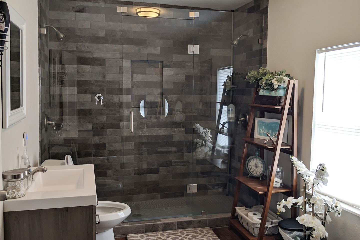 Large, beautifully renovated bathroom with dual-head stand up shower!!