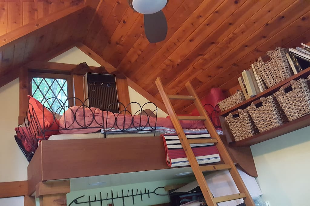 The loft sleeps one, comfortably and has great access to books. The perfect reading nook.