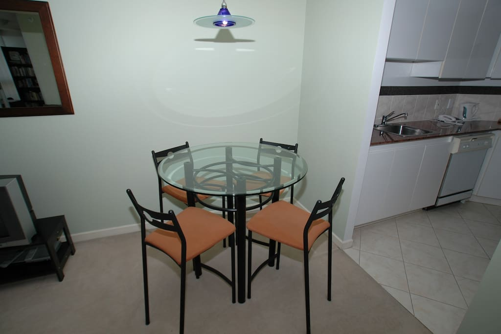 Dining area off kitchen seats 4. Stools are higher than a regular chair.