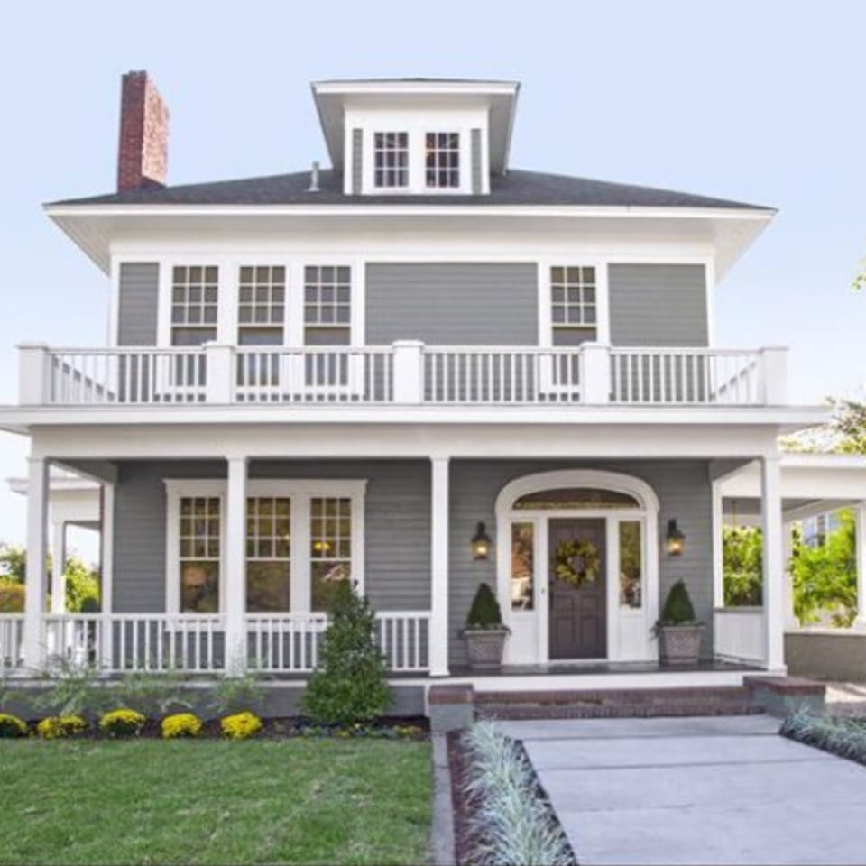 The original tiny home, built in 1889, was added onto in 1927 to look like this beautiful masterpiece.